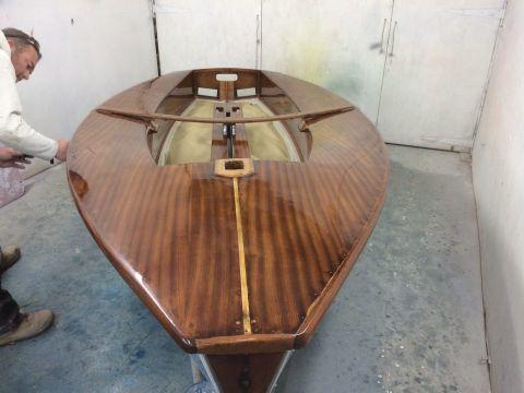 Solo dinghy varnished